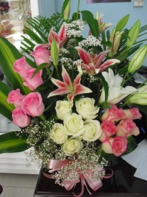 Lilies Roses Basket for AED 250 at Sharjah, Ajman