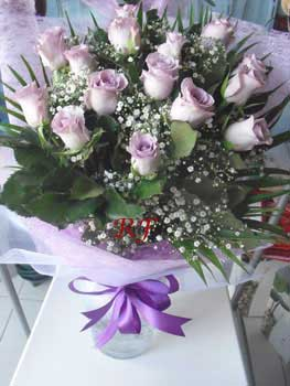 Enthrall - Delivery of Purple Roses Bouquet in Sharjah